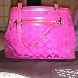 All pink inside and out coach hand bag